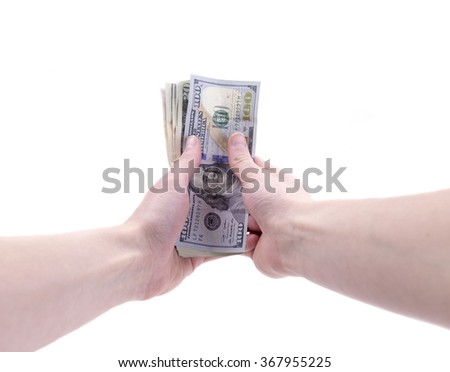Hand holding dollar bills