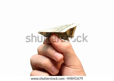 Hand holding dollar plane - stock photo