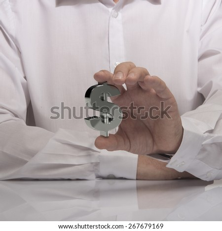 hand holding dollar sign, white shirt and reflexion. symbol of profit and making money - stock photo