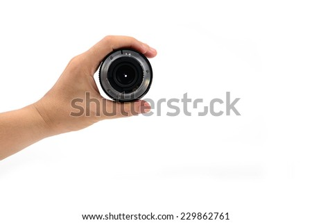 Hand holding DSLR lens from the left isolated on white - stock photo
