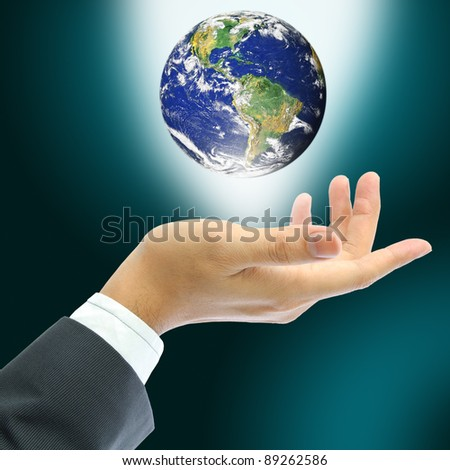 hand holding earth, Earth globe image provided by NASA - stock photo