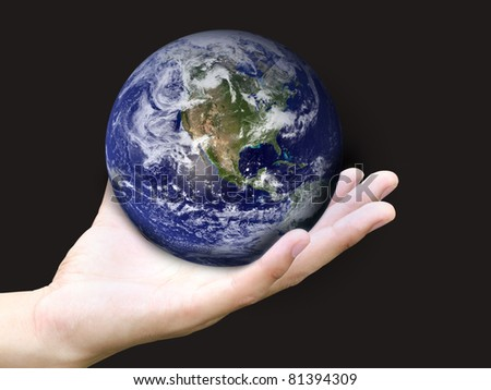 Hand holding earth (Earth view image from http://visibleearth.nasa.gov) - stock photo