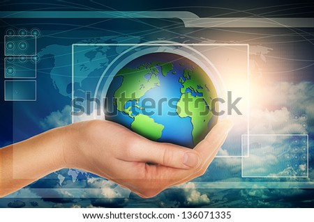 hand holding earth globe in blue virtual interface with clouds - stock photo