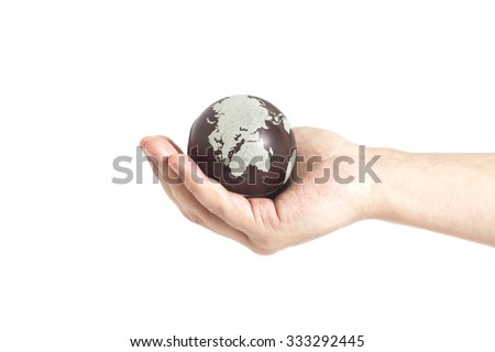 Hand holding Earth isolated on white