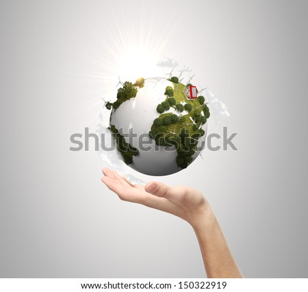 hand holding earth on blue background - stock photo