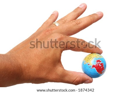 Hand holding Earth over white background - stock photo