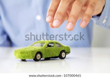 Hand Holding Eco car icon - stock photo
