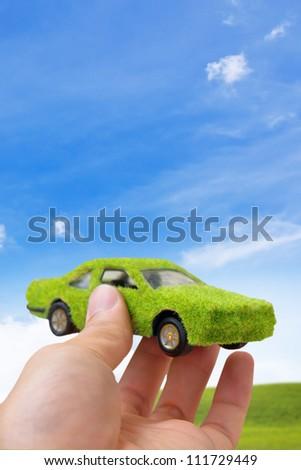 Hand Holding Eco car icon concept - stock photo