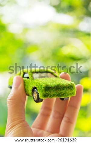 Hand Holding Eco car icon concept - stock photo