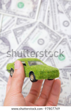 Hand Holding Eco car icon, save money concept - stock photo