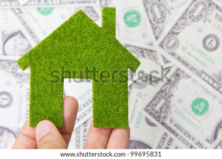 hand holding eco house icon, save money concept - stock photo