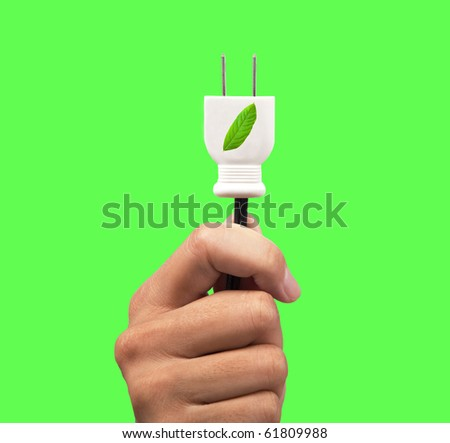 hand holding eco power plug and leaf logo with green background - stock photo