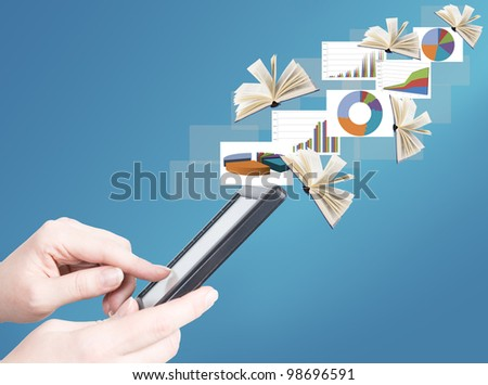 Hand holding electronic book and opened books and business diagrams flying away (education and business news concept) - stock photo