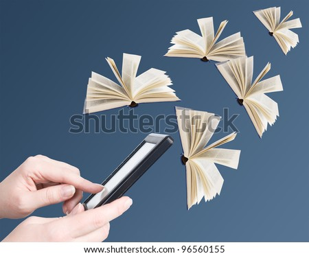 Hand holding electronic book and opened books flying away (education concept) - stock photo