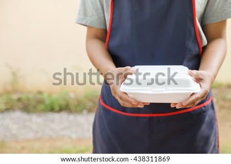 Hand holding empty styrofoam box.Dangerous of styrofoam box. - stock photo