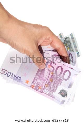 Hand holding euro bills - stock photo