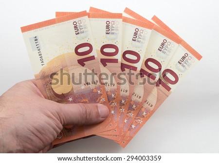 Hand holding 10 Euro notes - stock photo