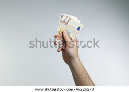 hand holding euros