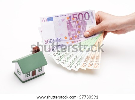 hand holding Euros; real estate loan concept - stock photo
