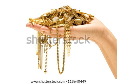 Hand Holding Expensive Gold Jewelry - stock photo
