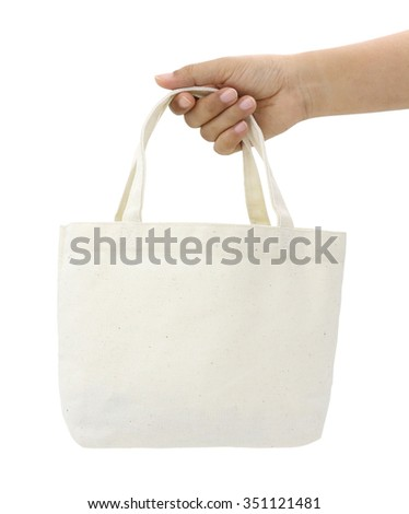 Hand holding fabric bag. (With PATH) - stock photo