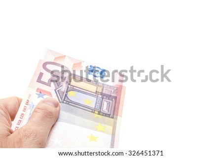 Hand holding fifty euro note. All on white background. - stock photo