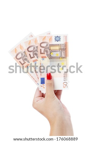 Hand holding fifty-euro notes - stock photo