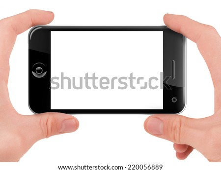Hand holding (filming or shooting) a smart phone (palmtop) with blank screen isolated on white - stock photo