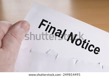 hand holding final notice or reminder letter - stock photo