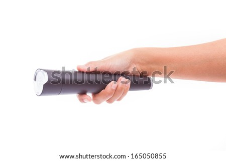 Hand holding flashlight on white background