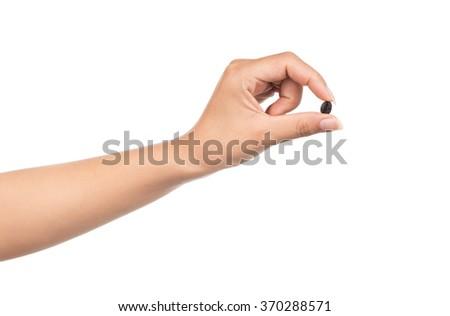 Hand holding Fresh roasted coffee bean isolated on white background - stock photo