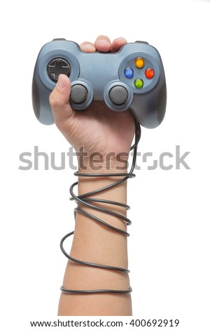 hand holding game controller and tied up with cables isolated on the white background - stock photo