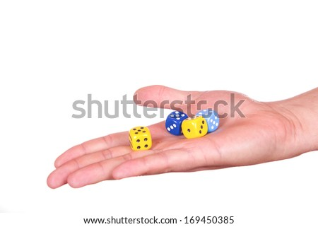 Hand holding game cubes isolated on white background