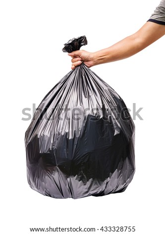 Hand holding garbage bag isolated on white background. - stock photo
