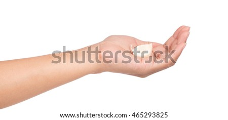 hand holding Garlic isolated on white background