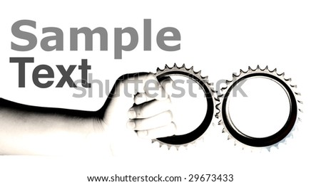 hand holding gears with copy space - stock photo
