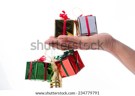 Hand holding  gift box on white background - stock photo