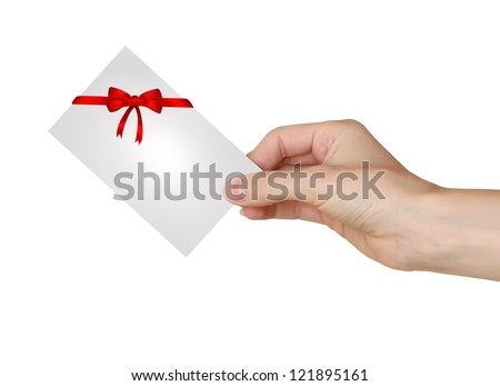 Hand holding gift card with red ribbon and beautiful bow isolated on white background - stock photo