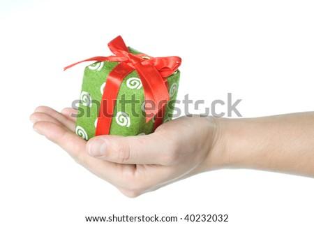 Hand holding gift isolated on white - stock photo