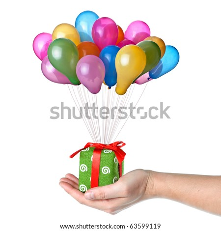 Hand holding gift with color balloons isolated on white - stock photo