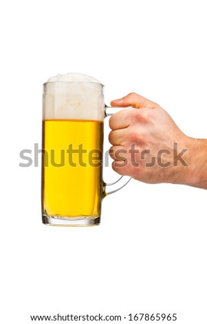 Hand holding glass of beer - stock photo