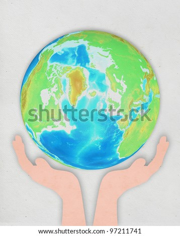 hand holding globe ,paper art design ,save the earth concept