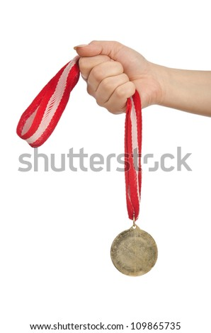 Hand holding gold medal on white - stock photo