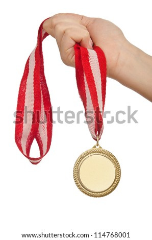 Hand holding gold medal on white - stock photo