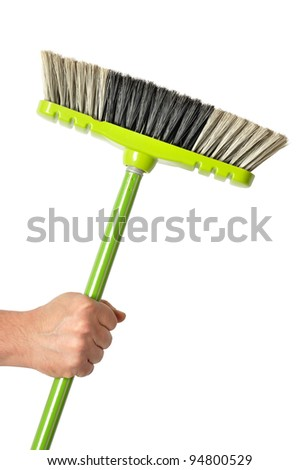 Hand holding green broom isolated on white background - stock photo