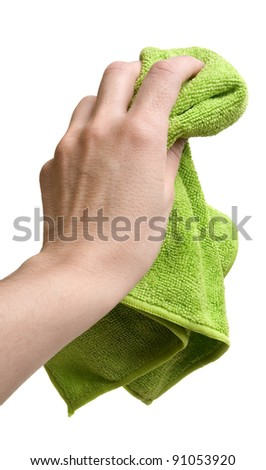 Hand holding green cleaning rag isolated on white - stock photo