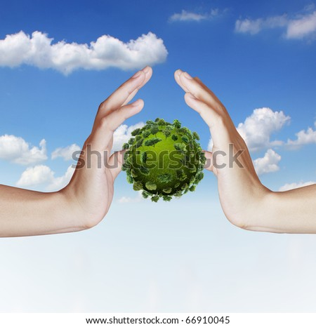 Hand holding green earth - stock photo