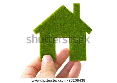 hand holding green Eco house icon concept - stock photo