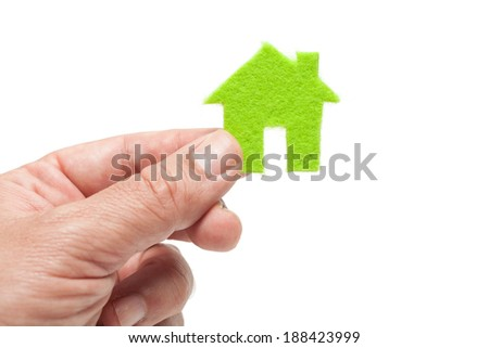 Hand Holding Green Icon House on White Background