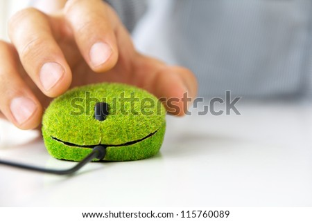 hand holding green mouse - stock photo